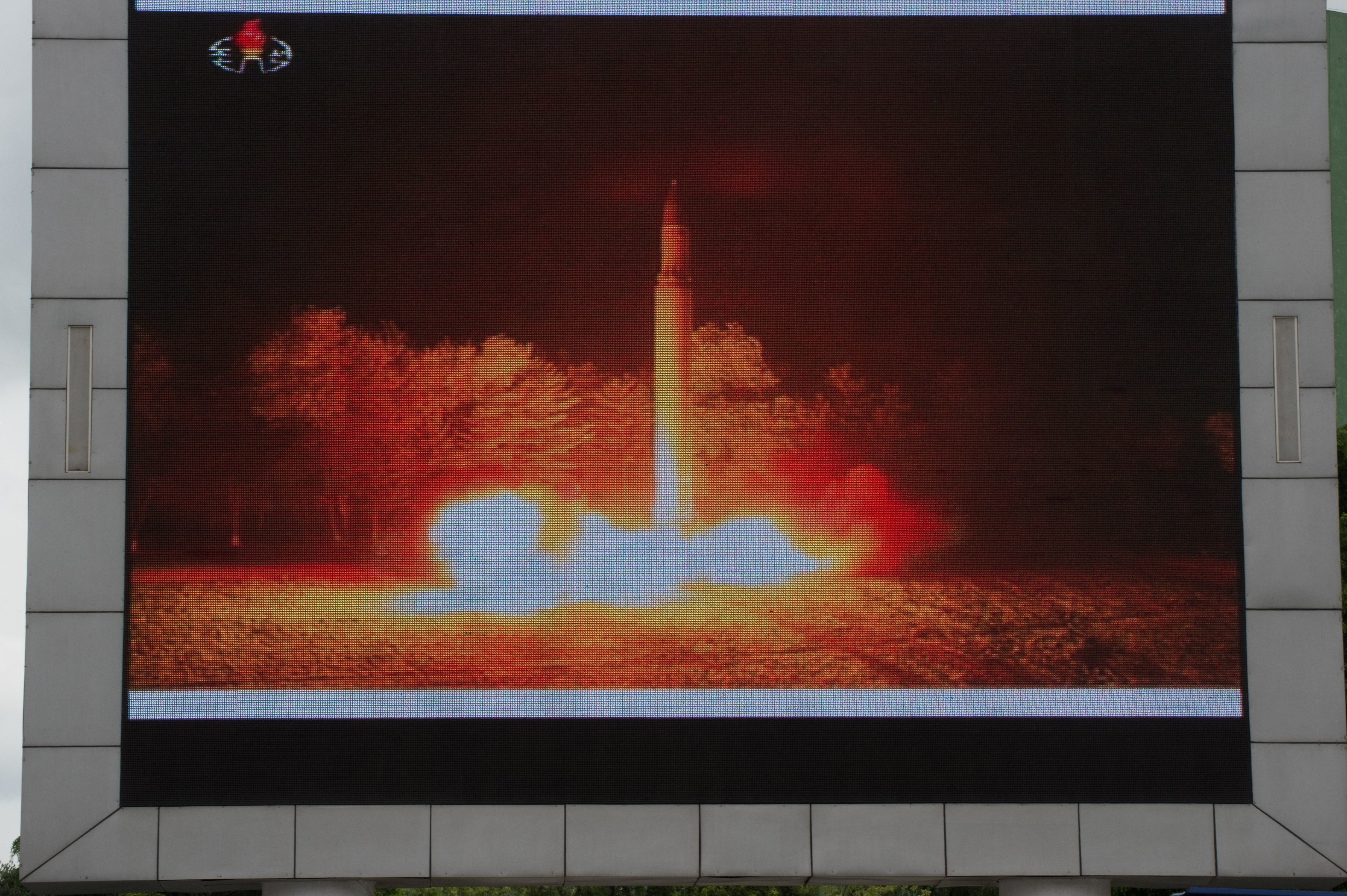 Coverage of an ICBM missile test is displayed on a screen in a public square in Pyongyang on July 29,