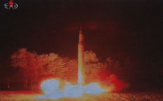 <strong>Coverage of an ICBM missile test is displayed on a screen in a public square in Pyongyang...