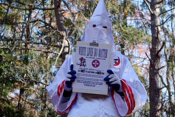 A member of the Ku Klux Klan who says his name is Gary Munker poses for a photo during an interview with AFP in Hampton Bays,