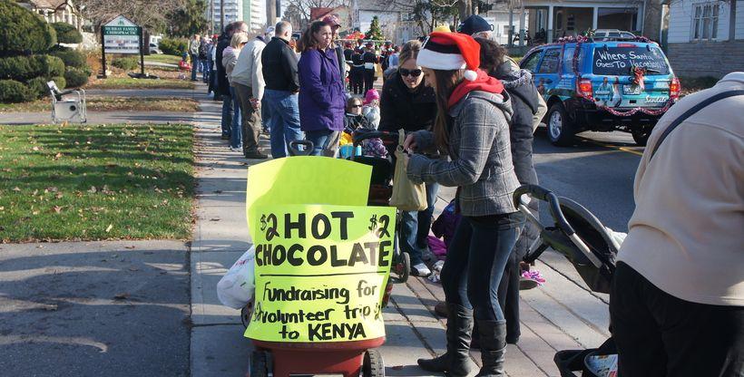 Selling hot chocolate at Santa Calus parade, to raise money for my volunteer trip