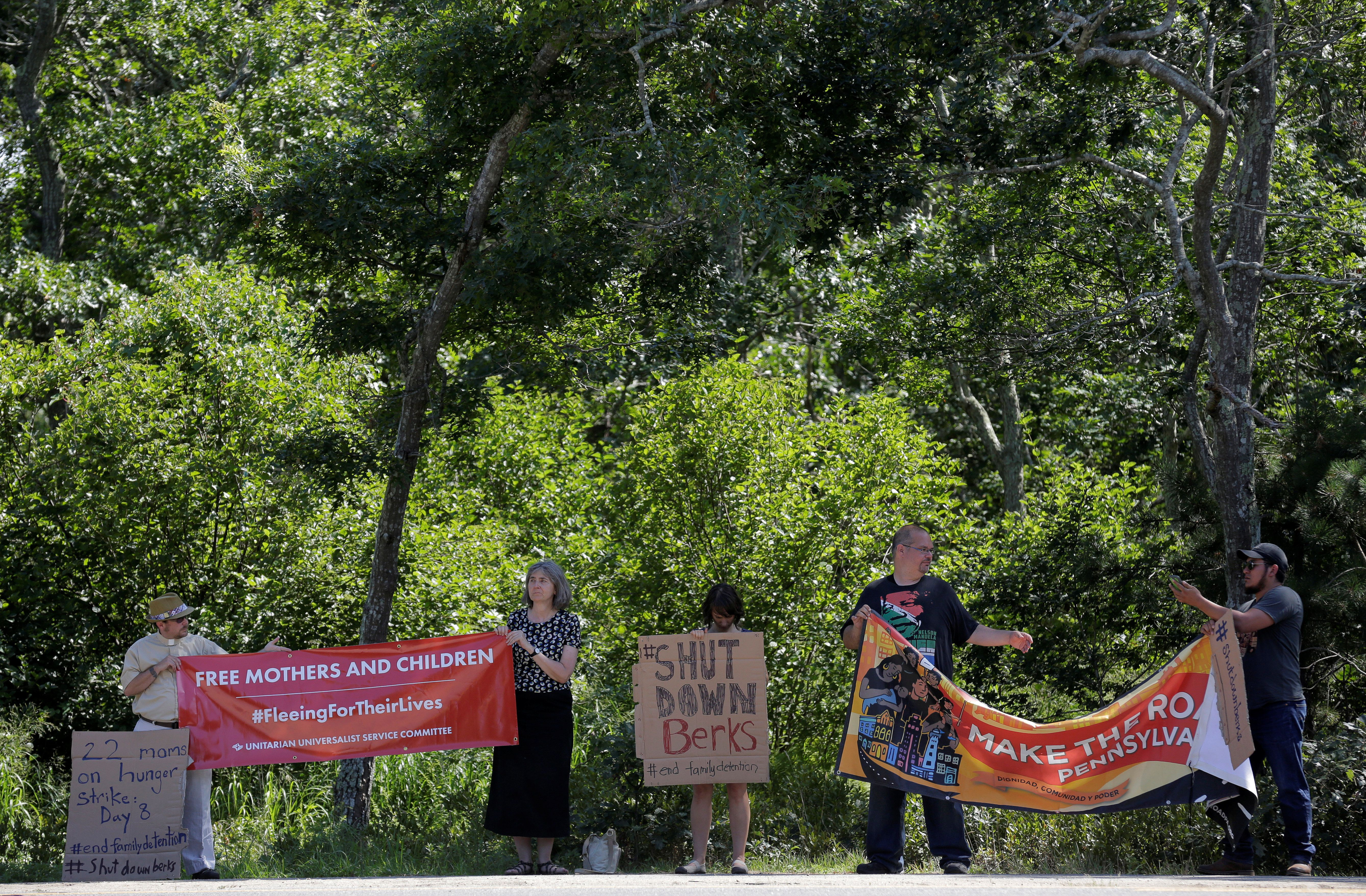 Protesters from the Unitarian Universalist Service Committee gather in front of where U.S. President Barack Obama is playing golf on his vacation in Edgartown, Massachusetts, U.S., August 15, 2016. The protesters are calling for the release of immigrant women on a hunger strike at the Berks County, Pennsylvania, migrant family detention center.     REUTERS/Joshua Roberts