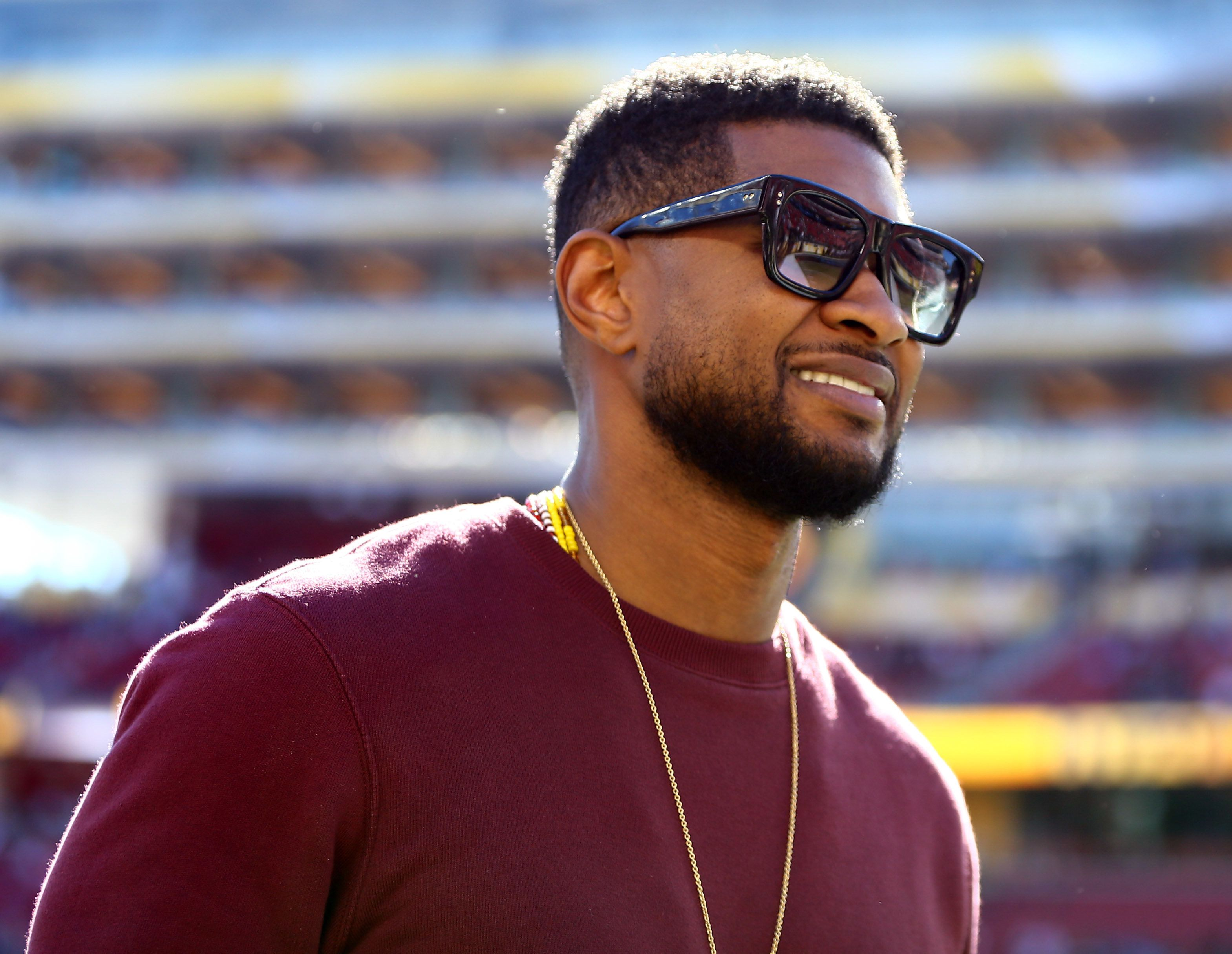 Feb 7, 2016; Santa Clara, CA, USA; Recording artist Usher on the field before Super Bowl 50 between the Carolina Panthers and the Denver Broncos at Levi's Stadium. Mandatory Credit: Mark J. Rebilas-USA TODAY Sports