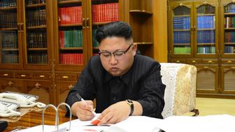 This picture from North Korea's official Korean Central News Agency (KCNA) taken on July 3, 2017 and released on July 4, 2017 shows North Korean leader Kim Jong-Un signing the order to carry out the test-fire of the intercontinental ballistic missile Hwasong-14 at an undisclosed location. North Korea declared on July 4 it had successfully tested its first intercontinental ballistic missile -- a watershed moment in its push to develop a nuclear weapon capable of hitting the mainland United States. / AFP PHOTO / KCNA VIA KNS / STR / South Korea OUT / REPUBLIC OF KOREA OUT   ---EDITORS NOTE--- RESTRICTED TO EDITORIAL USE - MANDATORY CREDIT 'AFP PHOTO/KCNA VIA KNS' - NO MARKETING NO ADVERTISING CAMPAIGNS - DISTRIBUTED AS A SERVICE TO CLIENTS THIS PICTURE WAS MADE AVAILABLE BY A THIRD PARTY. AFP CAN NOT INDEPENDENTLY VERIFY THE AUTHENTICITY, LOCATION, DATE AND CONTENT OF THIS IMAGE. THIS PHOTO IS DISTRIBUTED EXACTLY AS RECEIVED BY AFP.   /         (Photo credit should read STR/AFP/Getty Images)