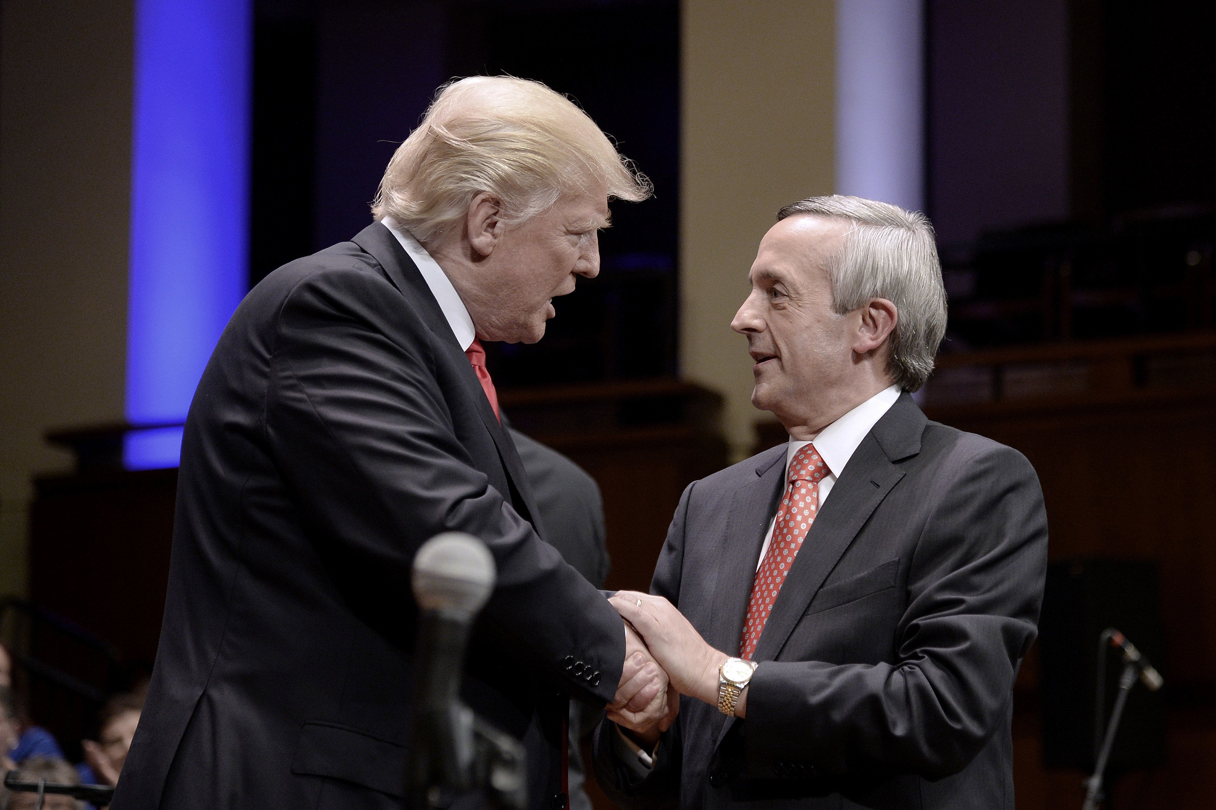 U.S. President Donald Trump, left, speaks with pastor Robert Jeffress during the 'Celebrate Freedom' event at the John F. Kennedy Center for the Performing Arts in Washington, D.C., U.S., on Saturday, July 1, 2017. Trump returned to the relatively calm waters of patriotism and supporting American troops in a speech on Saturday night that followed several outbursts against the media and others on social media earlier in the day. Photographer: Olivier Douliery/Bloomberg via Getty Images