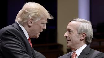 U.S. President Donald Trump, left, speaks with pastor Robert Jeffress during the 'Celebrate Freedom' event at the John F. Kennedy Center for the Performing Arts in Washington, D.C., U.S., on Saturday, July 1, 2017. Trumpreturned to the relatively calm waters of patriotism and supporting American troops in a speech on Saturday night that followed several outbursts against the media and others on social media earlier in the day. Photographer: Olivier Douliery/Bloomberg via Getty Images