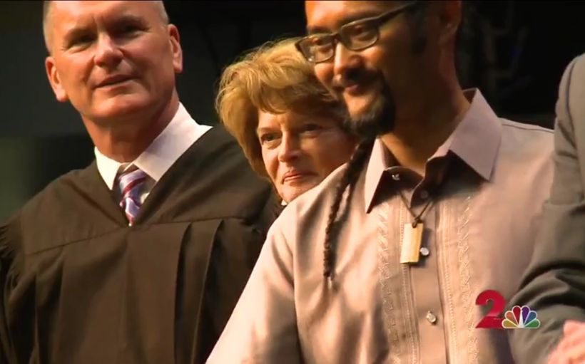 Federal District Court Judge Tim Burgess, U.S. Senator Lisa Murkowski, and E.J.R. David congratulating 136 new U.S. Citizens.