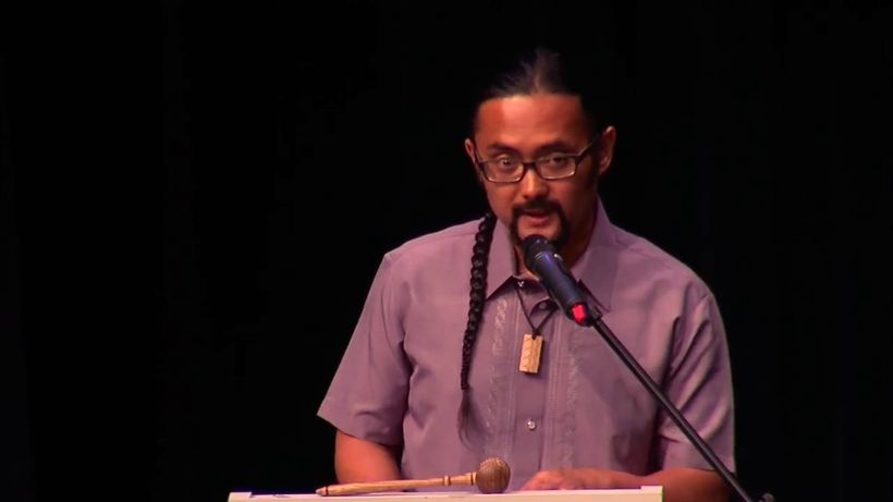 E.J.R. David speaking to 136 new U.S. Citizens and their families. Screen shot of YourAlaskaLink.com's coverage of a Naturali
