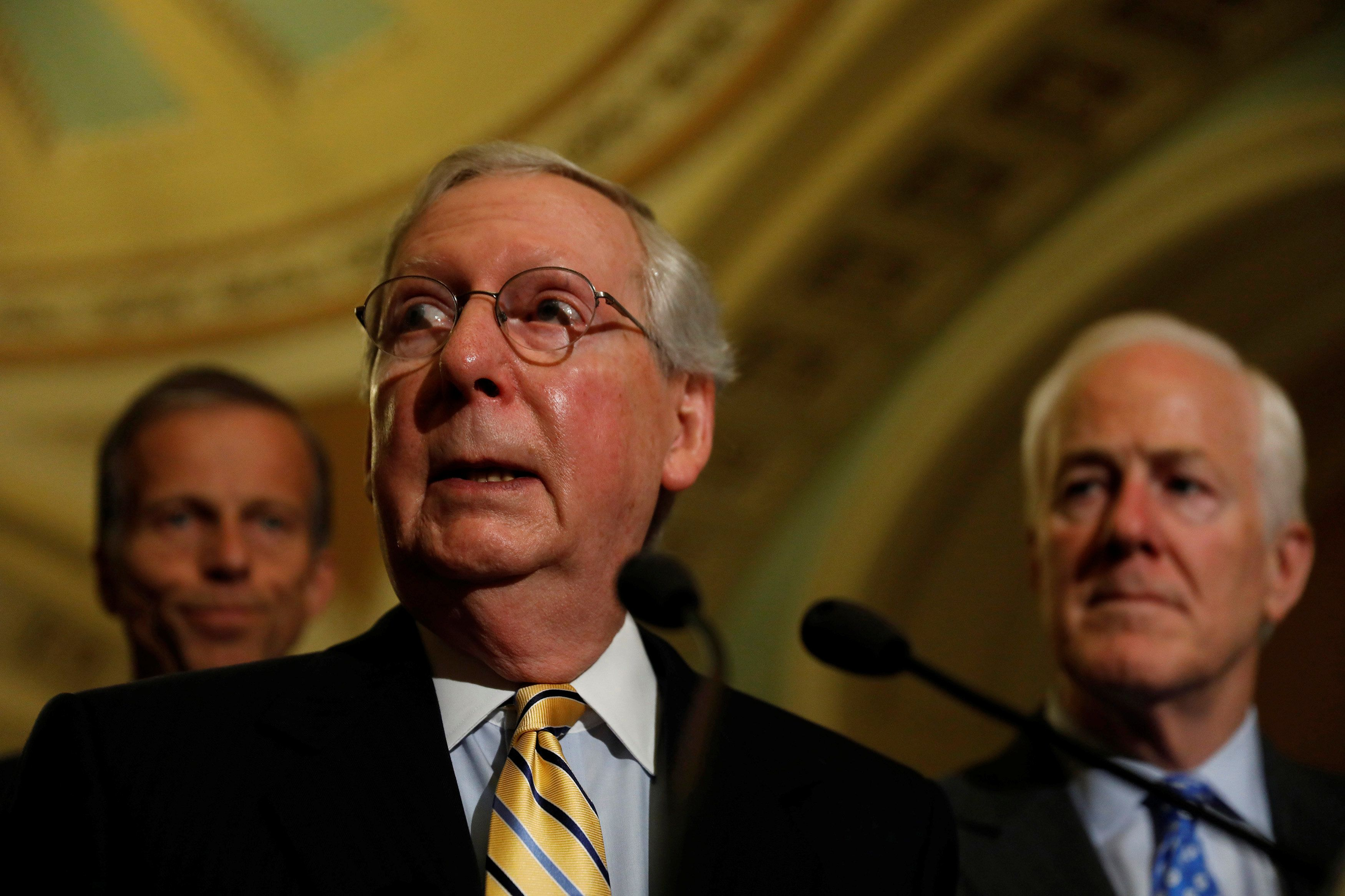 Senate Majority Leader Mitch McConnell, accompanied by Senator John Thune (R-SD) and Senator John Cornyn (R-TX), speaks with reporters following the successful vote to open debate on a health care bill on Capitol Hill in Washington, U.S., July 25, 2017. REUTERS/Aaron P. Bernstein