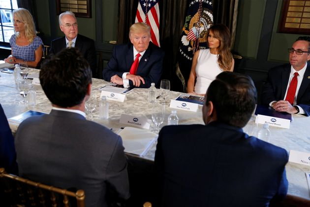 Donald Trump (C) with first lady Melania Trump (R) meets with Secretary of Health and Human Services...