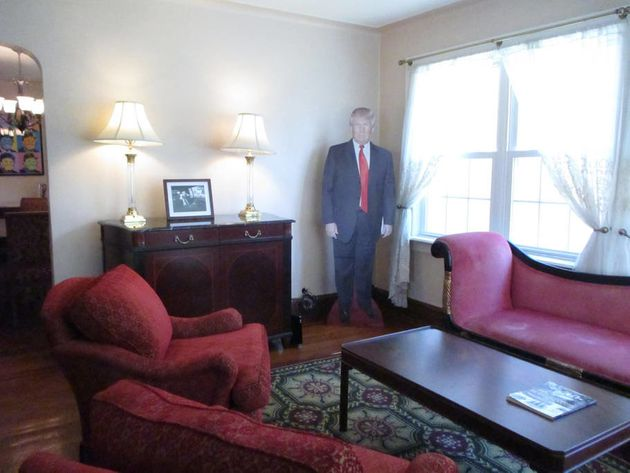 In the photo above, you can see two additional photographs and prints of Trump as