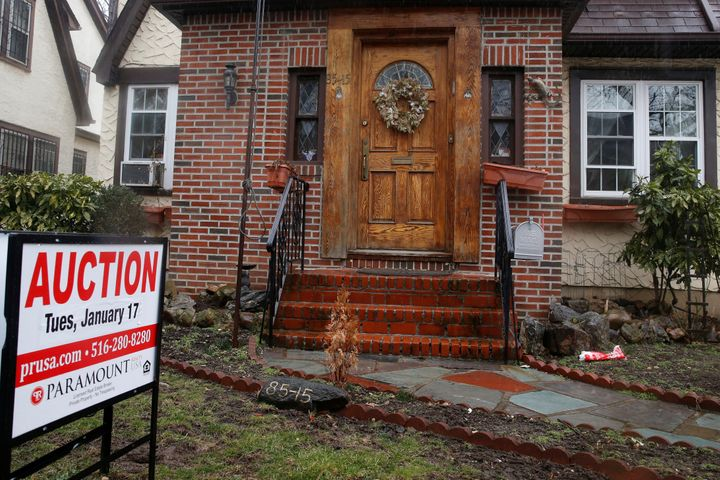 A childhood home of U.S. President-elect Donald Trump is seen with an auction sign in the Queens borough of New York on Jan.17. It was sold a few months later.