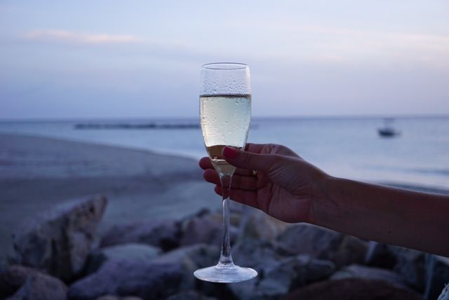 Enjoying a glass of prosecco while watching the sunset at Four Seasons Resort Nevis, Mango Restaurant