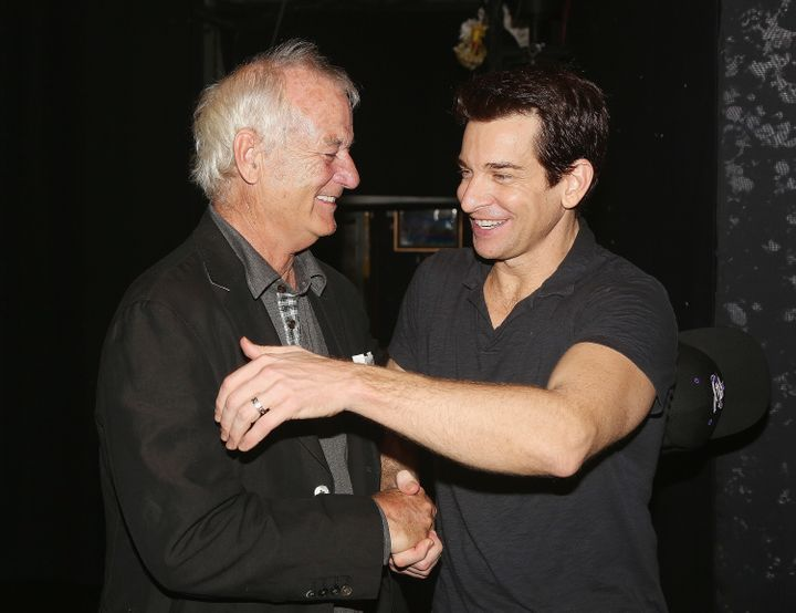 Bill Murray (who played Phill Connors in the film) and Andy Karl (who plays Phil Connors in the musical) embrace.