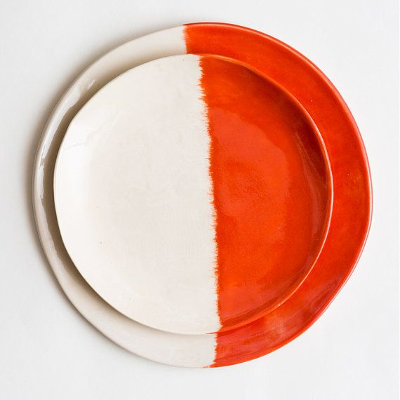 """Orange is a huge trend in home decor right now, and these symmetrical, painted plates allow you to add colorful person"