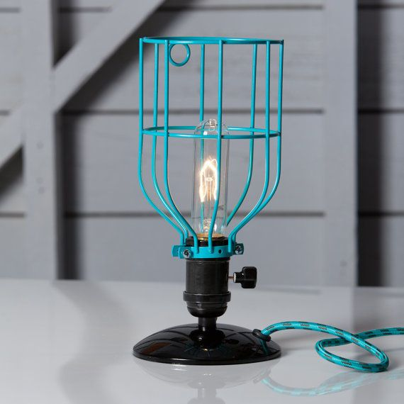 """A desk lamp can be just as pretty as it is functional. Choose a bright option to add a peek of color to your desk or b"