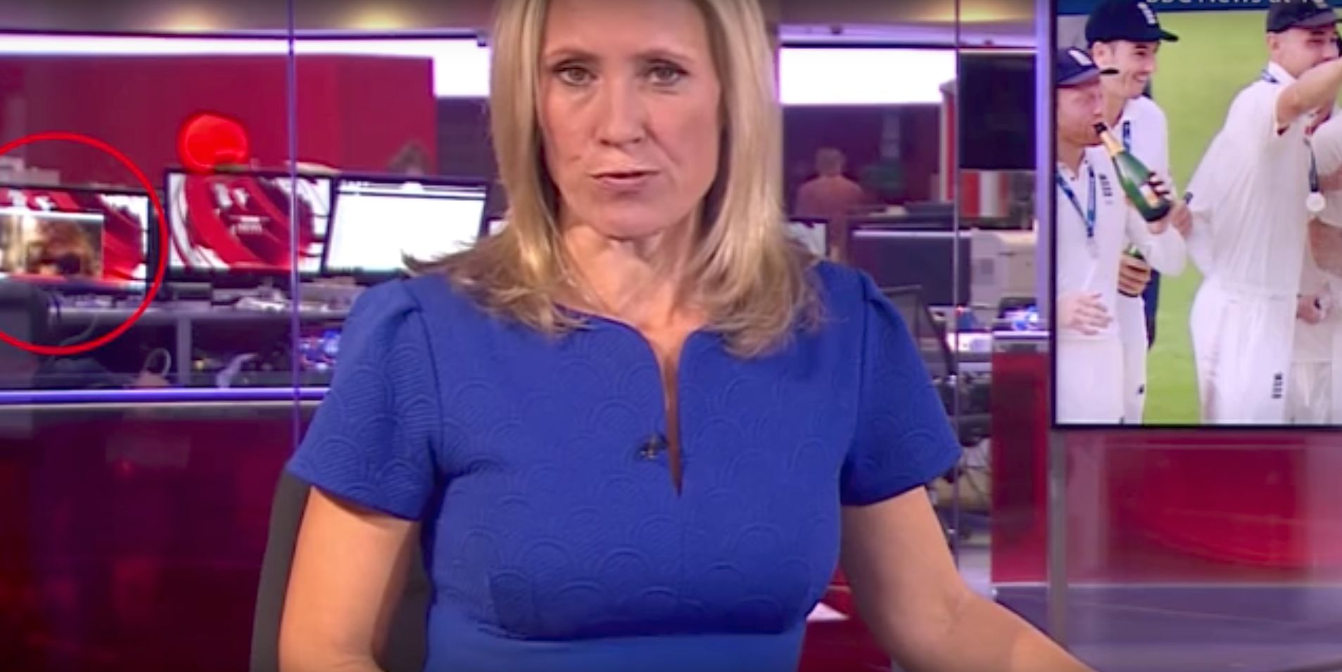 A womans breasts were exposed in the background of a BBC News broadcast on Tuesday night