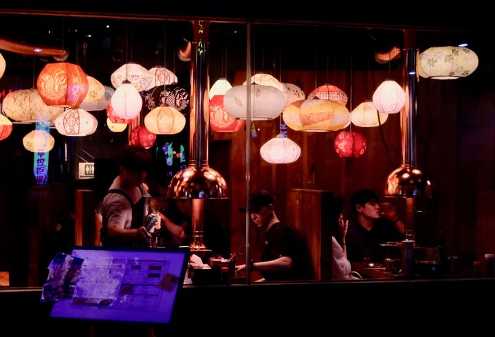 "Seoul residents enjoy a late night dinner hours after U.S. President Donald Trump vowed to unleash ""fire and fury&"