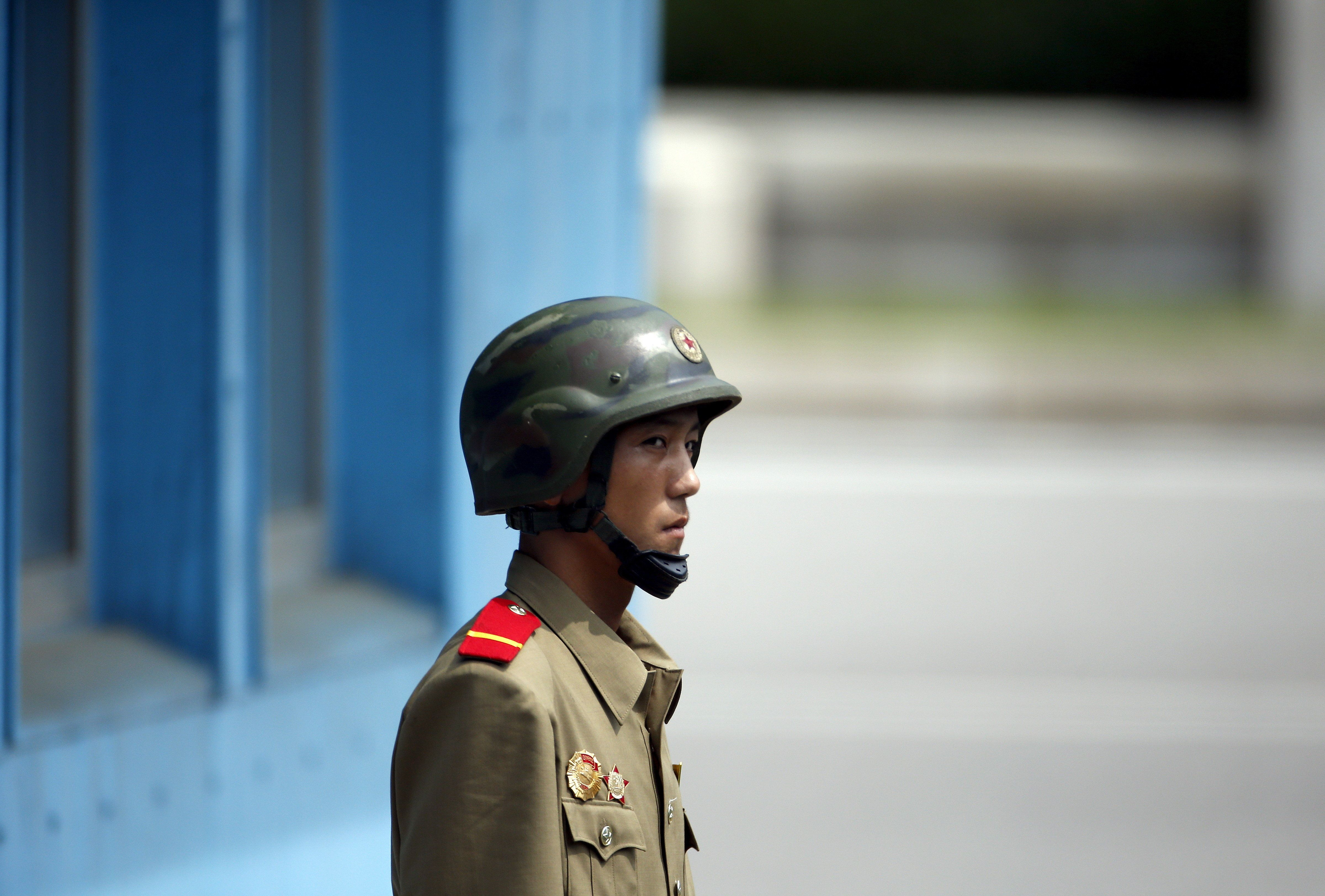 A North Korean soldier keeps watch on the south at the truce village of Panmunjom in the demilitarized...