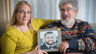 OMAHA, UNITED STATES - JANUARY 11: (L-R) Mary Rich and her husband, Joel Rich hold a photo of their son in their home in Omaha, Nebraska, on January 11, 2017. Seth Rich, a 27-year-old staffer for the Democratic National Committee, was killed in the Bloomingdale neighborhood of Washington, D.C., on July 10, 2016. (Photo by Matt Miller for The Washington Post via Getty Images)