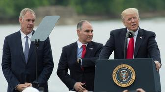 US President Donald Trump, with US Secretary of the Interior Ryan Zinke (L) and EPA Administrator Scott Pruitt, speaks in Cincinnati, Ohio, on June 7, 2017. Trump spoke about infrastructure and healthcare. / AFP PHOTO / NICHOLAS KAMM        (Photo credit should read NICHOLAS KAMM/AFP/Getty Images)