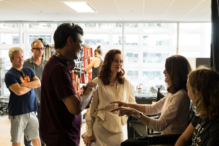 "Destin Daniel Cretton, Brie Larson and Jeanette Walls talk on the set of ""The Glass Castle."""