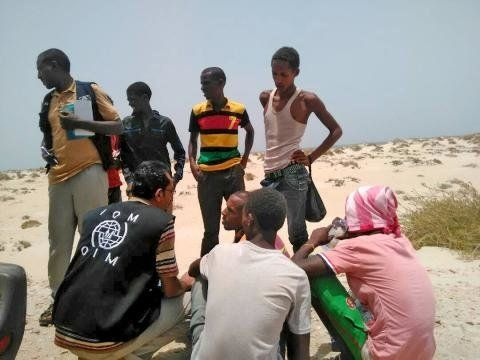 UN International Organization for Migration IOM staff assist Somali and Ethiopian migrants who were forced into the sea by smugglers