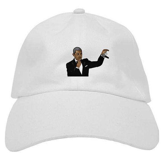 "Buy the <a href=""https://www.etsy.com/listing/538904707/barack-obama-drop-mic-low-profile-hat?ref=shop_home_active_15"" target"