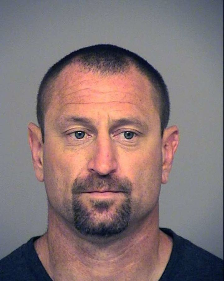 Andrew David Jensen in a booking photo.