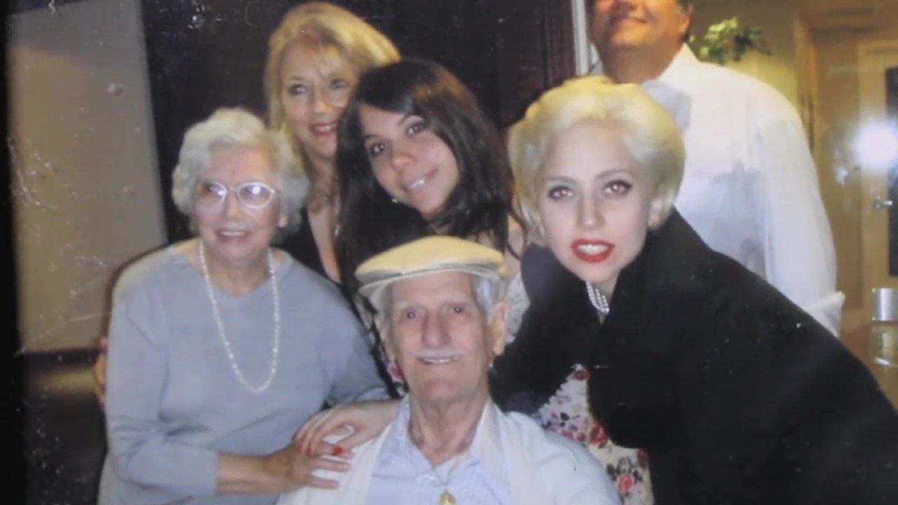 Lady Gaga poseswith family members gathered around her grandfather.