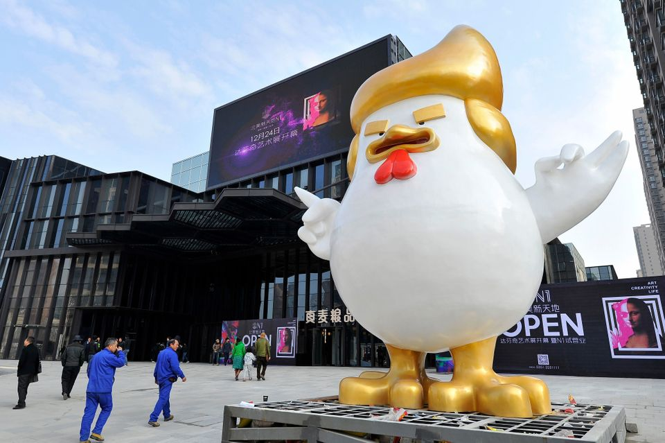 This photo taken on December 24, 2016 shows a giant chicken sculpture outside a shopping mall in Taiyuan, north China's Shanx