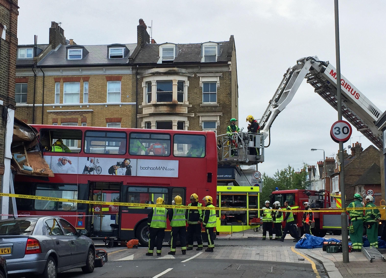 Double decker bus crashes into shop in London, traps passengers