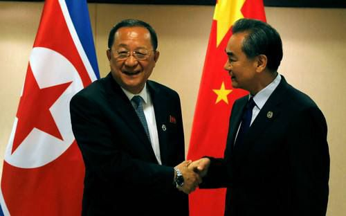 North Korean Foreign Minister Ri Yong-ho and Chinese Foreign Minister Wang Yi. The picture was taken when the both attended t