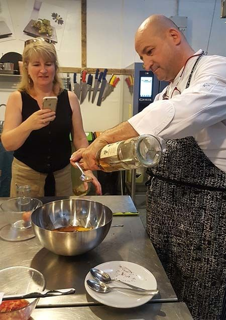 <em>Chef Marco Giachello measuring rum during the Turin Epicurean Capital 2017 cooking class (courtesy Hannau)</em>