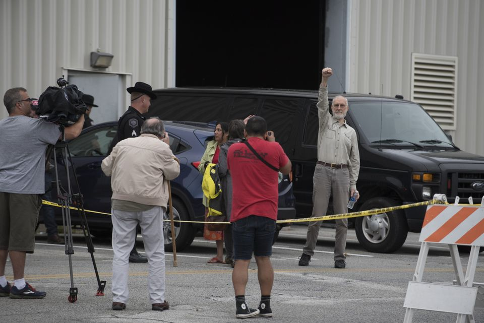 James Cromwell raises a fist outside the Orange County jail after turning himself in for his part...