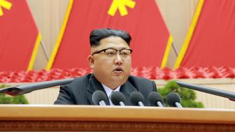 North Korean leader Kim Jong Un speaks during the first party committee meeting in Pyongyang, in this undated photo released by North Korea's Korean Central News Agency (KCNA) December 25, 2016. REUTERS/KCNA   ATTENTION EDITORS - THIS PICTURE WAS PROVIDED BY A THIRD PARTY. REUTERS IS UNABLE TO INDEPENDENTLY VERIFY THE AUTHENTICITY, CONTENT, LOCATION OR DATE OF THIS IMAGE. FOR EDITORIAL USE ONLY. NOT FOR SALE FOR MARKETING OR ADVERTISING CAMPAIGNS. NO THIRD PARTY SALES. NOT FOR USE BY REUTERS THIRD PARTY DISTRIBUTORS. SOUTH KOREA OUT. NO COMMERCIAL OR EDITORIAL SALES IN SOUTH KOREA. THIS PICTURE IS DISTRIBUTED EXACTLY AS RECEIVED BY REUTERS, AS A SERVICE TO CLIENTS.