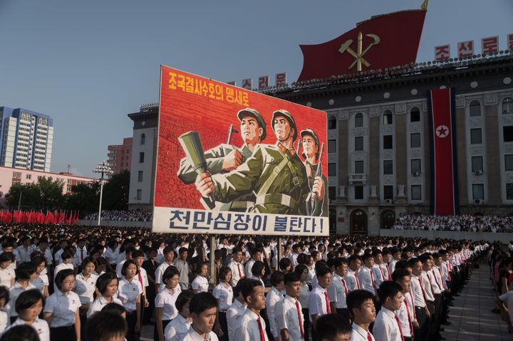 North Koreans rally in support of their country's stance against the U.S. in Kim Il-Sung square in Pyongyang.