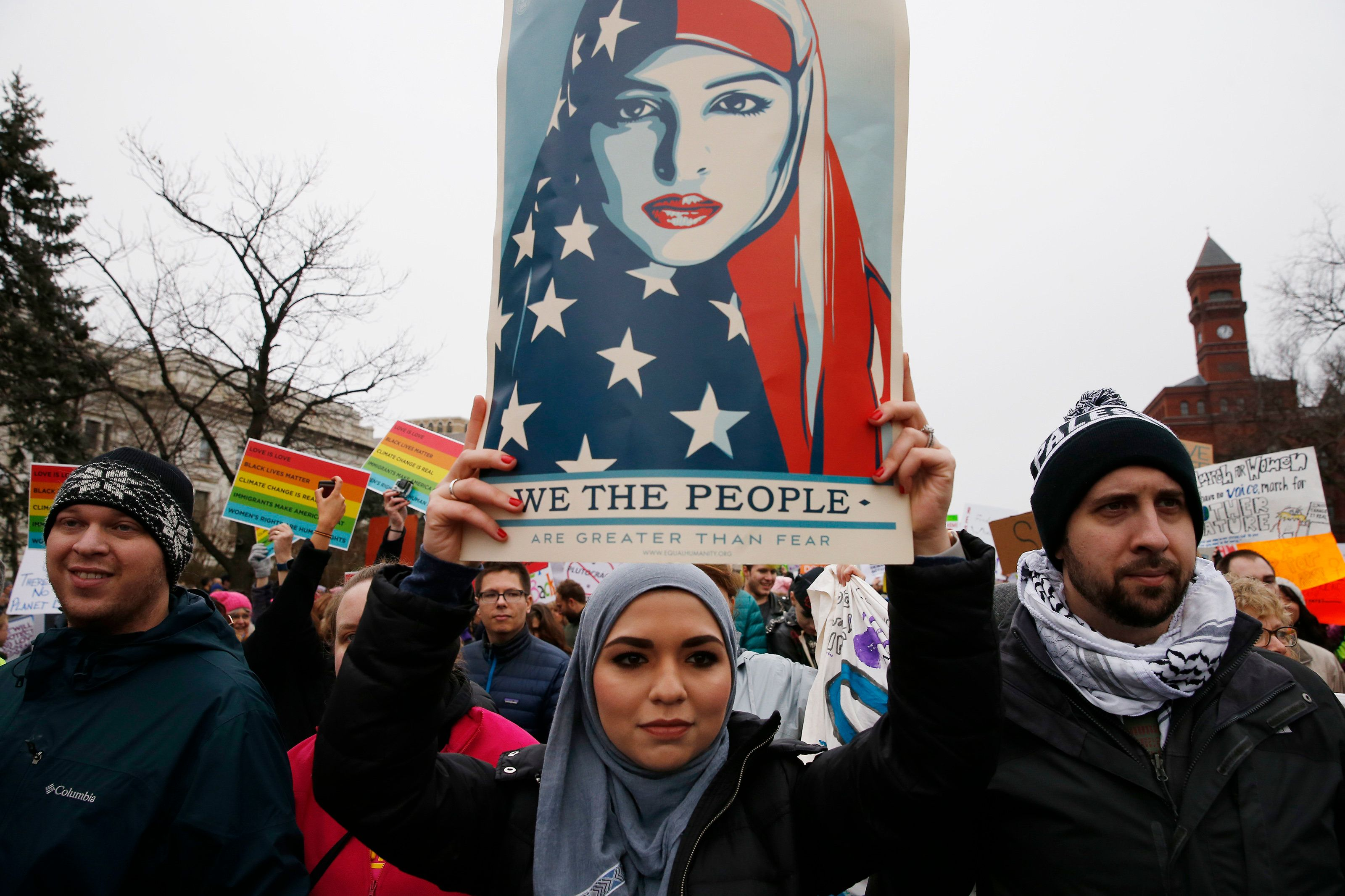 WASHINGTON, DC - JANUARY 21: A woman carries a 'We the people are greater than fear,' sign as she takes part in the Women's March on Washington, Jan. 21, 2017. (Photo by Jessica Rinaldi/The Boston Globe via Getty Images)