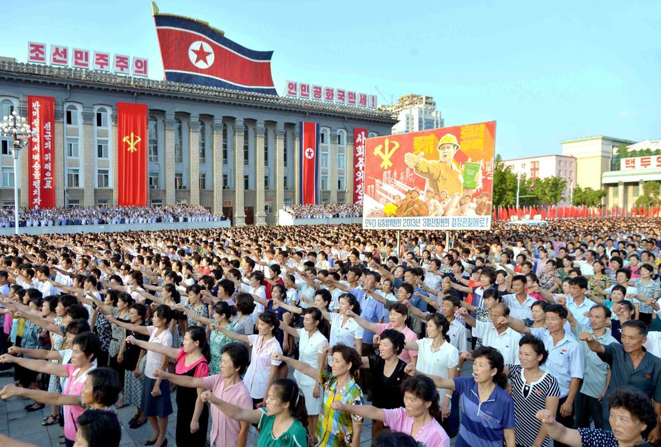 People participate in a Pyongyang city mass rally held at Kim Il Sung Square on August 9, 2017, to fully support the statemen