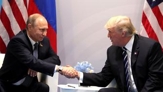 HAMBURG, GERMANY - JULY 7: (----EDITORIAL USE ONLY  MANDATORY CREDIT - ' RUSSIAN PRESIDENTIAL PRESS AND INFORMATION OFFICE / HANDOUT' - NO MARKETING NO ADVERTISING CAMPAIGNS - DISTRIBUTED AS A SERVICE TO CLIENTS----)  Russia's President Vladimir Putin (L) and US President Donald Trump (R) shake hands during a bilateral meeting on the sidelines of the  G20 summit in Hamburg, Germany, on July 7, 2017.  (Photo by Russian Presidential Press and Information Office/Anadolu Agency/Getty Images)