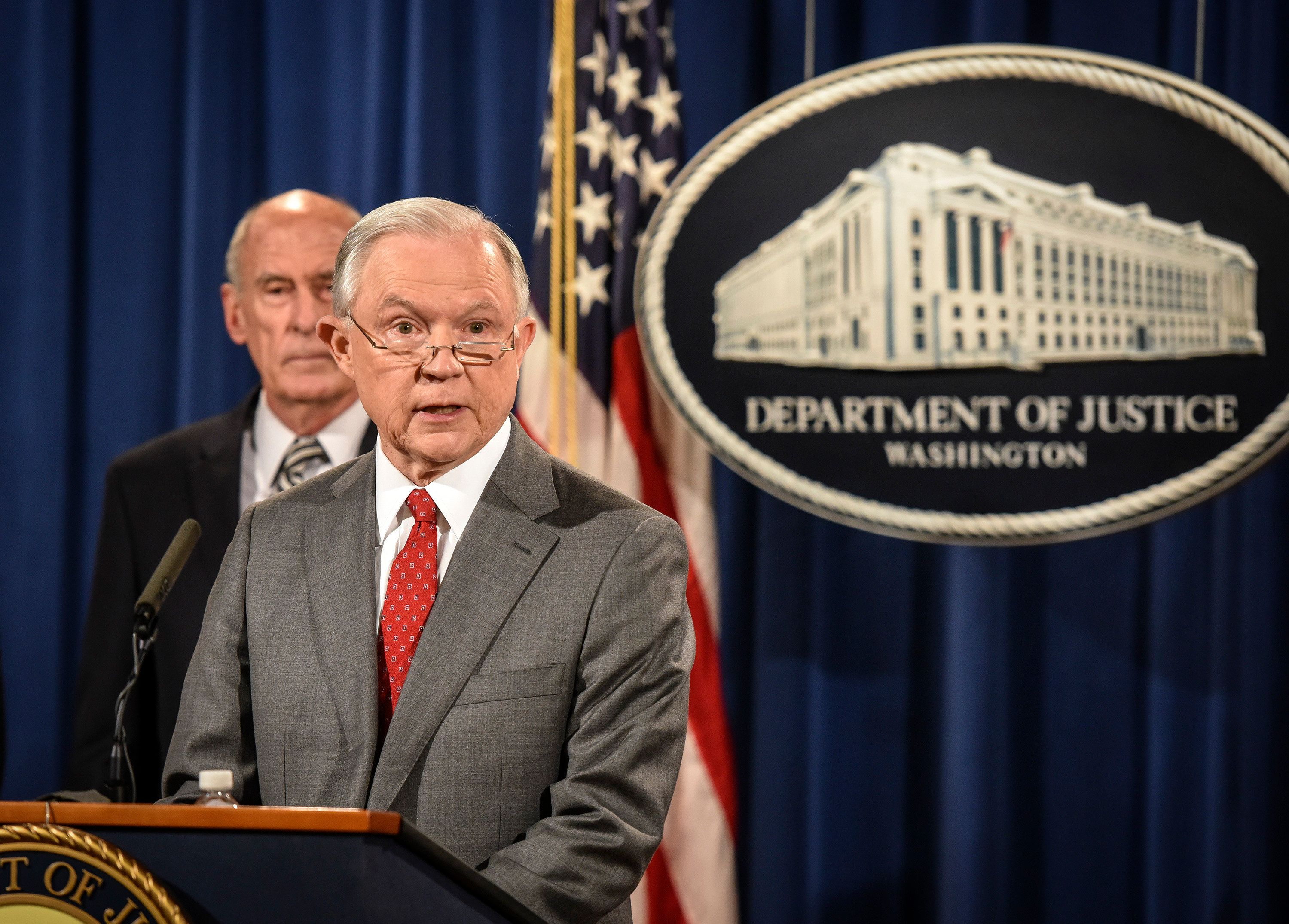 WASHINGTON, DC - AUGUST 4: Attorney General Jeff Sessions, right, holds a press conference announcing on-going leak investigations, on August, 04, 2017 in Washington, DC. Behind him is Director of National Intelligence Dan Coats. (Photo by Bill O'Leary/The Washington Post via Getty Images)