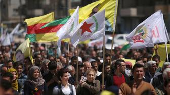 Kurds carry flags as they protest, in the northeastern city of Qamishli, against Turkish airstrikes on the headquarters of the Kurdish fighters from the People's Protection Units (YPG) in Mount Karachok on Tuesday, Syria April 26, 2017. REUTERS/Rodi Said