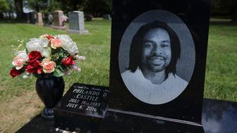 The grave of Philando Castile at Calvary Cemetery in St. Louis on the one-year anniversary of his death on Thursday, July 6, 2017. Minnesota police officer Jeronimo Yanez fatally shot and killed Castile during a traffic stop in 2016. During the traffic stop Castile, a licensed gun owner, volunteered that he had a gun and moments later officer Yanez fatally shot Castile, who was seat belted in his car. Yanez was charged with manslaughter in Castile's death but was found not guilty by a jury. (David Carson/St. Louis Post-Dispatch/TNS via Getty Images)