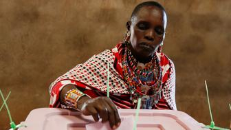 A Maasai tribeswoman votes during the Presidential election at a polling station in Olepolos primary school in Kisamis, Kenya August 8, 2017. REUTERS/Thomas Mukoya
