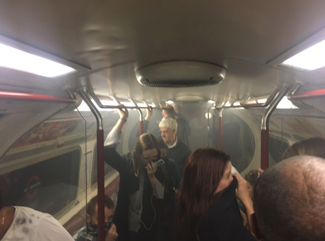 Commuters on a smoke-filled