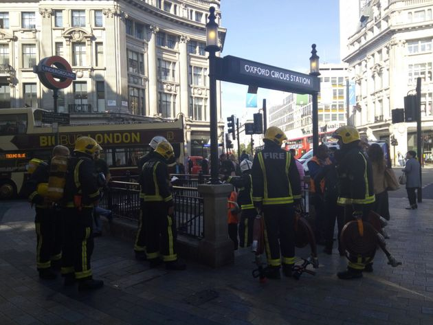 Fire-fighters entering the tube station this