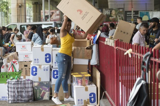 Volunteers organising boxes of donations following near Grenfell Tower in west London during the immediate...