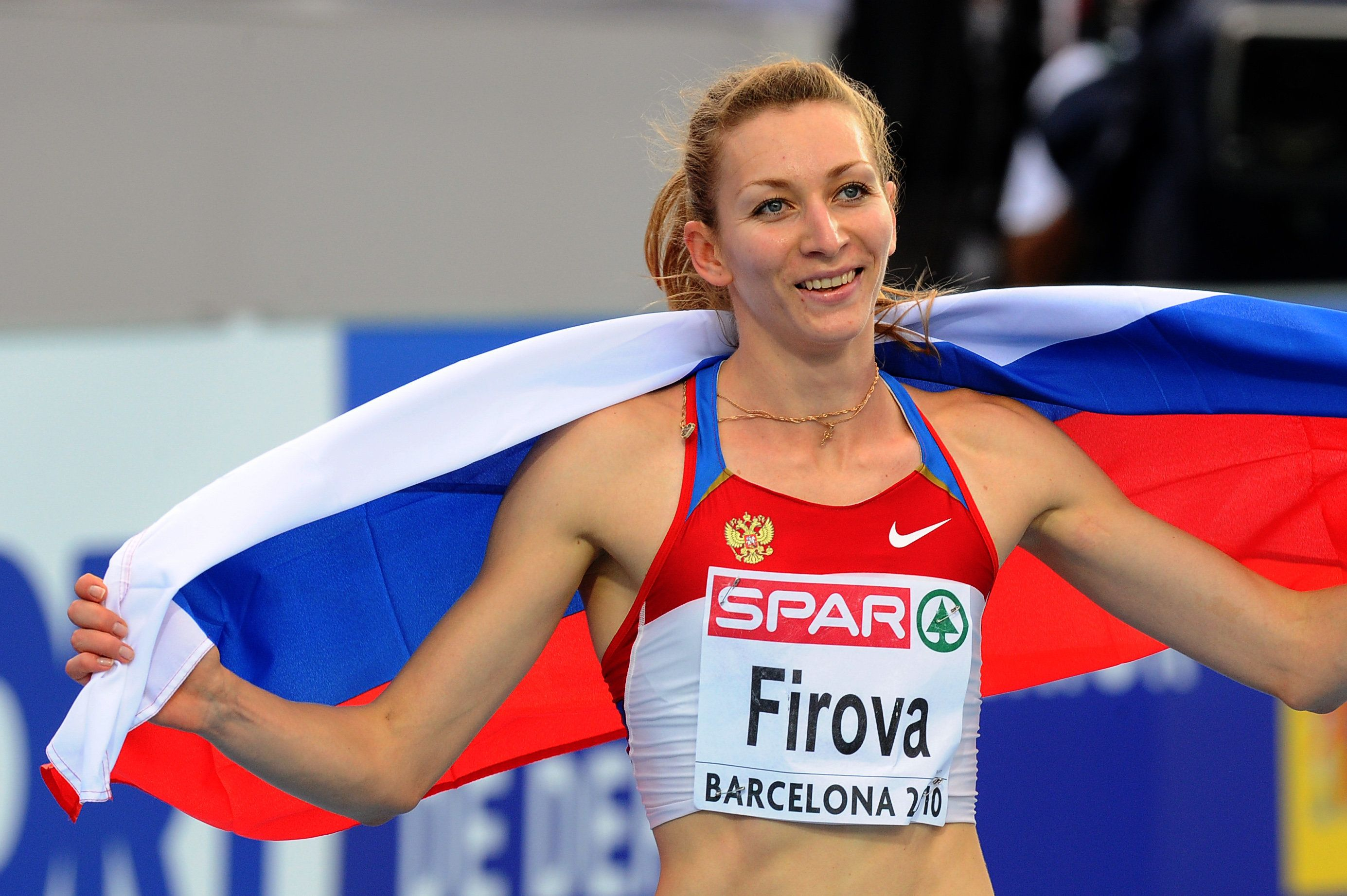 Russia's Tatyana Firova reacts after winning the women's 400m final at the 2010 European Athletics Championships at the Olympic Stadium in Barcelona on July 30, 2010. AFP PHOTO / LLUIS GENE (Photo credit should read LLUIS GENE/AFP/Getty Images)