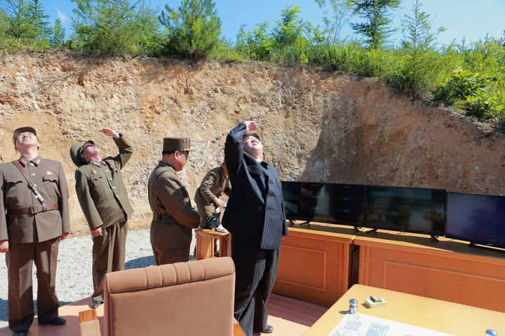 North Korean leader Kim Jong Un looks on during the test launch of the intercontinental ballistic missile Hwasong-14 in this