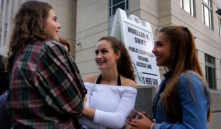 Grace Jarecke, 16, left, Lucy Peterson, 17, and Dani Kuta, 17, right, all from Denver, wait in line to attend the civil case for Taylor Swift vs David Mueller at the Alfred A. Arraj Courthouse on August 8, 2017 in Denver, Colorado.