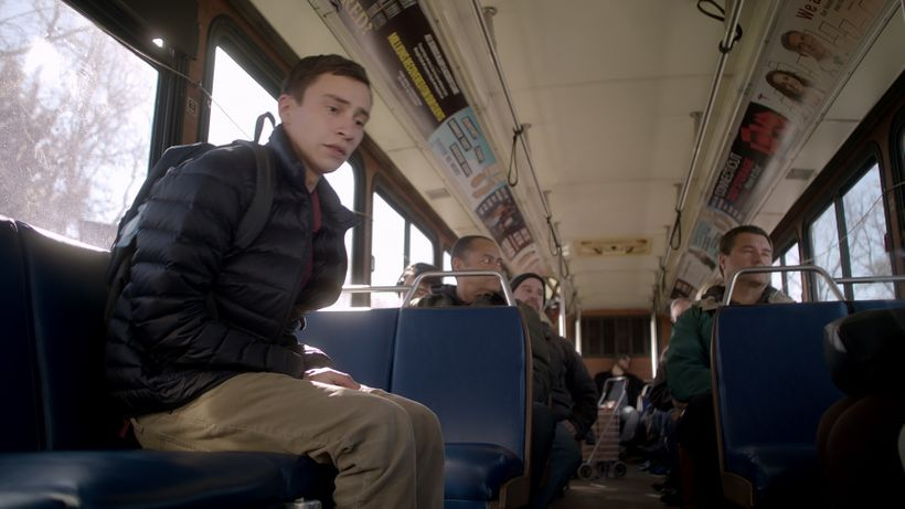 When Sam rides the bus, he can't let his back touch the seat.